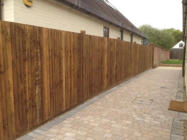 Domestic fence panels installed on a customers drive
