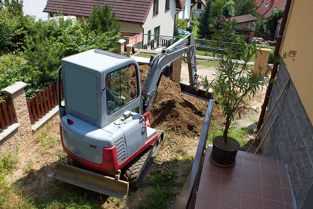 A mini digger in a customers garden