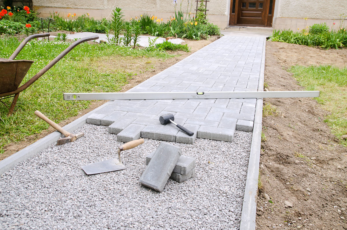 Paving path being laid in a garden