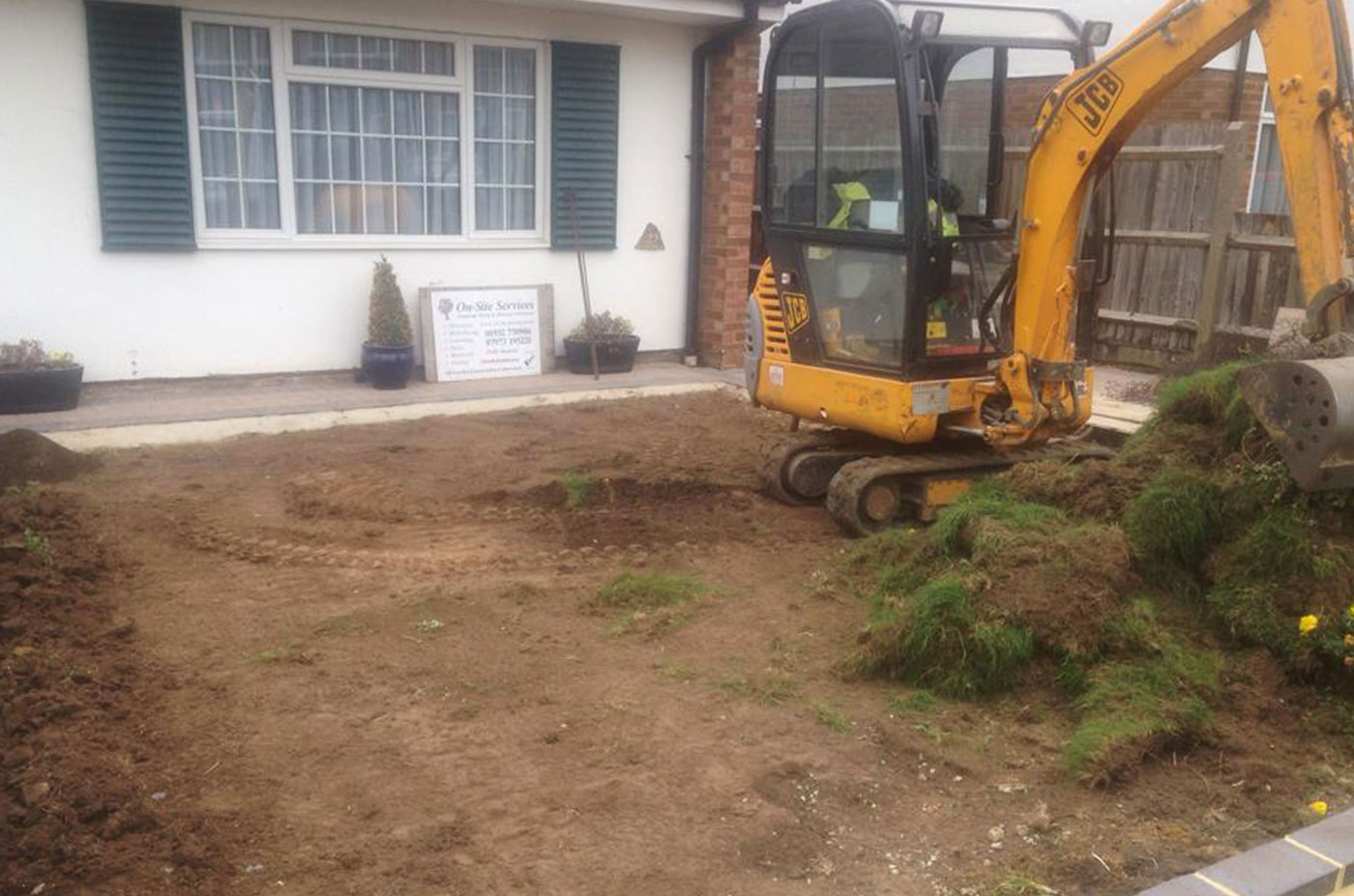 Mini digger hired to clear a customers front garden